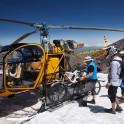 "Russia. North face of Elbrus. Riders Nikolay Pukhir and Petr Vinokurov. Heliaction company's helicopter ""Lama"" - pilot Alexander Davydov. Photo: Ludmila Zvegintseva"