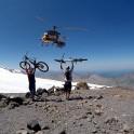 "Russia. North face of Elbrus. Riders Nikolay Pukhir and Petr Vinokurov. Heliaction company's helicopter ""Lama"" - pilot Alexander Davydov. Photo: Konstantin Galat"