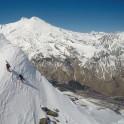 Russia, Caucasus, Elbrus region. Mt.Cheget. Riders Igor Ilynikh and Konstantin Galat climb to start-point. Photo by Oleg Kolmovskiy (drone)